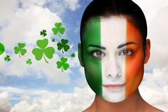Composite image of brunette in irish face paint Stock Photography