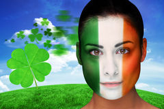 Composite image of brunette in irish face paint Stock Image