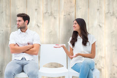 Composite image of brunette pleading with angry boyfriend Stock Photography