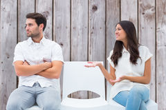 Composite image of brunette pleading with angry boyfriend Stock Photos