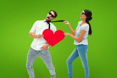Composite image of brunette pulling her boyfriend by the tie Stock Photography