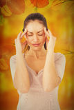 Composite image of brunette suffering from migraine Royalty Free Stock Photos