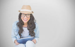 Composite image of brunette with tablet pc Royalty Free Stock Photos