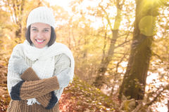 Composite image of brunette in warm clothing Royalty Free Stock Photo