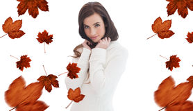 Composite image of brunette in white jumper smiling at camera Stock Image
