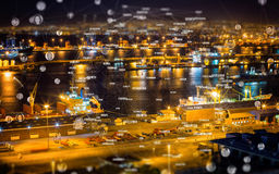 Composite image of bubbles with portraits. Bubbles with portraits against illuminated harbor against cityscape Stock Photo