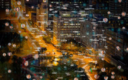Composite image of bubbles with portraits. Bubbles with portraits against illuminated roads by buildings in city Stock Image