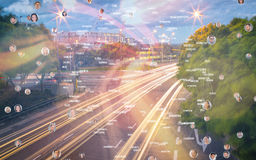 Composite image of bubbles with portraits. Bubbles with portraits against light trails on city street Royalty Free Stock Images