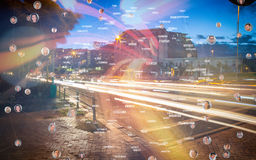Composite image of bubbles with portraits. Bubbles with portraits against light trails on city street Royalty Free Stock Photos