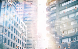 Composite image of bubbles with portraits. Bubbles with portraits against view of the city buildings Royalty Free Stock Photos
