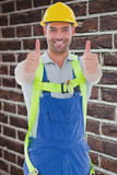 Composite image of builder in safety gear Royalty Free Stock Image