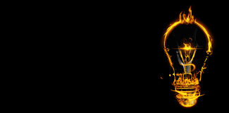 Composite image of bulb on fire on white background. Bulb on fire on white background against black Royalty Free Stock Photography