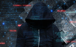 Composite image of burglar wearing black hooded jacket Stock Images