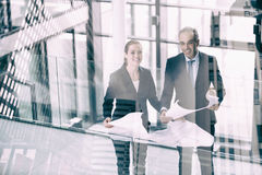 Composite image of business colleagues against view of modern office building Royalty Free Stock Image