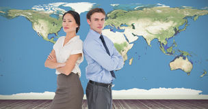 Composite image of business colleagues with arms crossed in office Stock Images