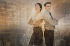 Composite image of business colleagues with arms crossed in office Royalty Free Stock Images