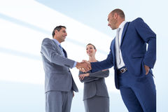 Composite image of business colleagues greeting each other Royalty Free Stock Images