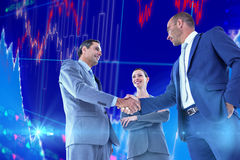 Composite image of business colleagues greeting each other Stock Images