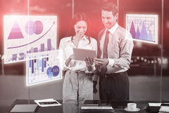 Composite image of business colleagues looking laptop against graph Stock Images