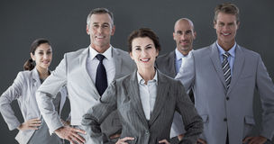 Composite image of business colleagues standing in a row Stock Image