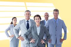 Composite image of business colleagues standing in a row Royalty Free Stock Photos