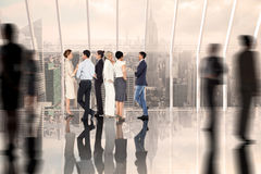 Composite image of business colleagues talking Royalty Free Stock Photo