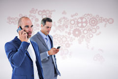 Composite image of business colleagues using phones Stock Image