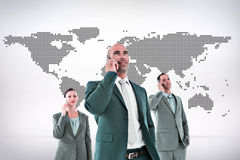 Composite image of business colleagues using phones Stock Photo