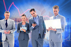 Composite image of business colleagues using their multimedia devices Royalty Free Stock Images