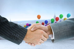 Composite image of business handshake against balloon Stock Photography