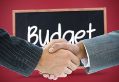 Composite image of business handshake against budget Stock Images