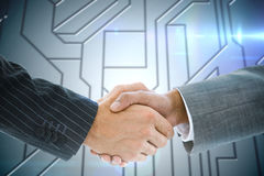 Composite image of business handshake against circuit board Stock Photography