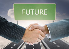 Composite image of business handshake against future board Stock Photos