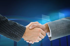 Composite image of business handshake against glowing Stock Image