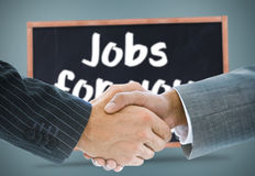 Composite image of business handshake against jobs Stock Image