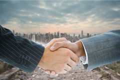 Composite image of business handshake Stock Photos