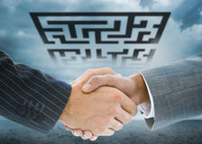 Composite image of business handshakeagainst puzzle maze Royalty Free Stock Photography