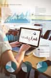 Composite image of business interface with graphs and data. Business interface with graphs and data against rear view of woman using her laptop Royalty Free Stock Images