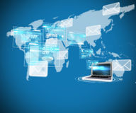 Composite image of business interfaces and laptop Royalty Free Stock Photography