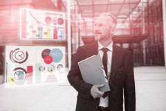 Composite image of business man against graph Royalty Free Stock Photos