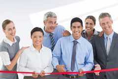 Composite image of business man cutting red strip royalty free stock image