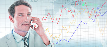 Composite image of business man having phone call Stock Photo