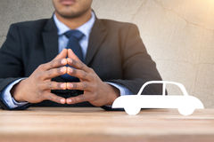 Composite image of business man sitting behind a desk Royalty Free Stock Images