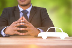 Composite image of business man sitting behind a desk Royalty Free Stock Image