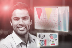 Composite image of business man smiling against colored graph Royalty Free Stock Photos