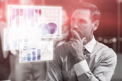 Composite image of business man thinking against graph. Graph against thoughtful businessman in office Royalty Free Stock Images
