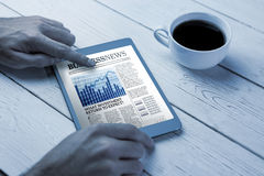 Composite image of business newspaper Stock Photos