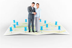 Composite image of business partners with clipboard stock images