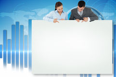 Composite image of business partners showing card Stock Photo
