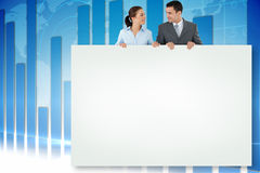 Composite image of business partners showing card Royalty Free Stock Photography